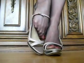 Nylon feet in silver high heel sandals