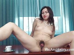 Vita enjoys coffee and masturbates on her table