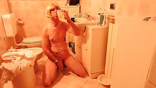Crossdresser Lilly drink his own piss