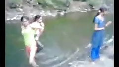 Indian girl in river with theri bfs
