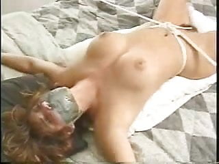 Tori Sinclair tied to a bed and teased with a vibrator