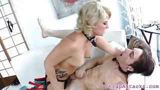 Busy domina pleasures her sub with a strapon 's Thumb