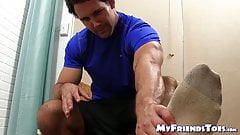 Attractive hunk plays around with feet and massages them