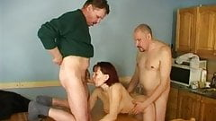 Redhead fucked by 2 dudes
