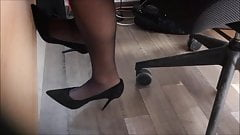 coworker in black pantyhose and high heels