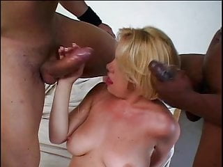 C-cup blonde kneels to suck two black cocks, then dude fucks her shaved pussy