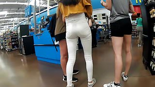 Tight white jeans showing off teen pussy gap
