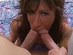 Big booty milf takes on two cocks