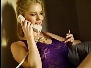 Gorgeous blonde smokes during phone sex