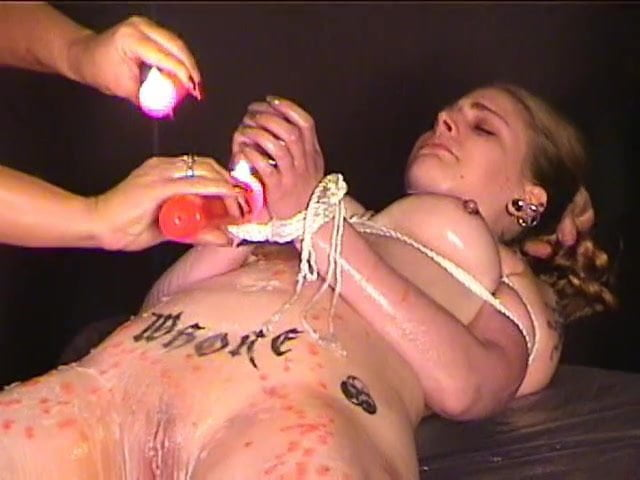 Tattooed slut bound from odd angle then teased with Samurai sword