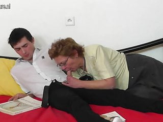 Hairy mother checks her toyboy's home work