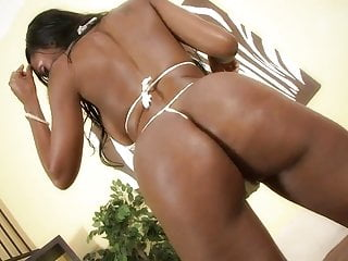 Ebony with an olied up butt rides cock reverse cowgirl