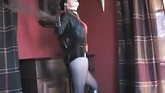 Leather domina in hotpants