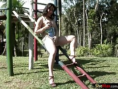 Girlish tranny gets naked and strokes in public playground