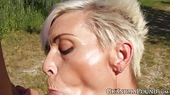 Granny with a body of a girl sucking cock in nature