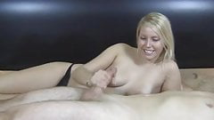 Cute blond gives a nice handjob