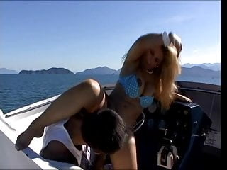Blonde skank loves huge dick in all her holes as she fucks outside on a boat