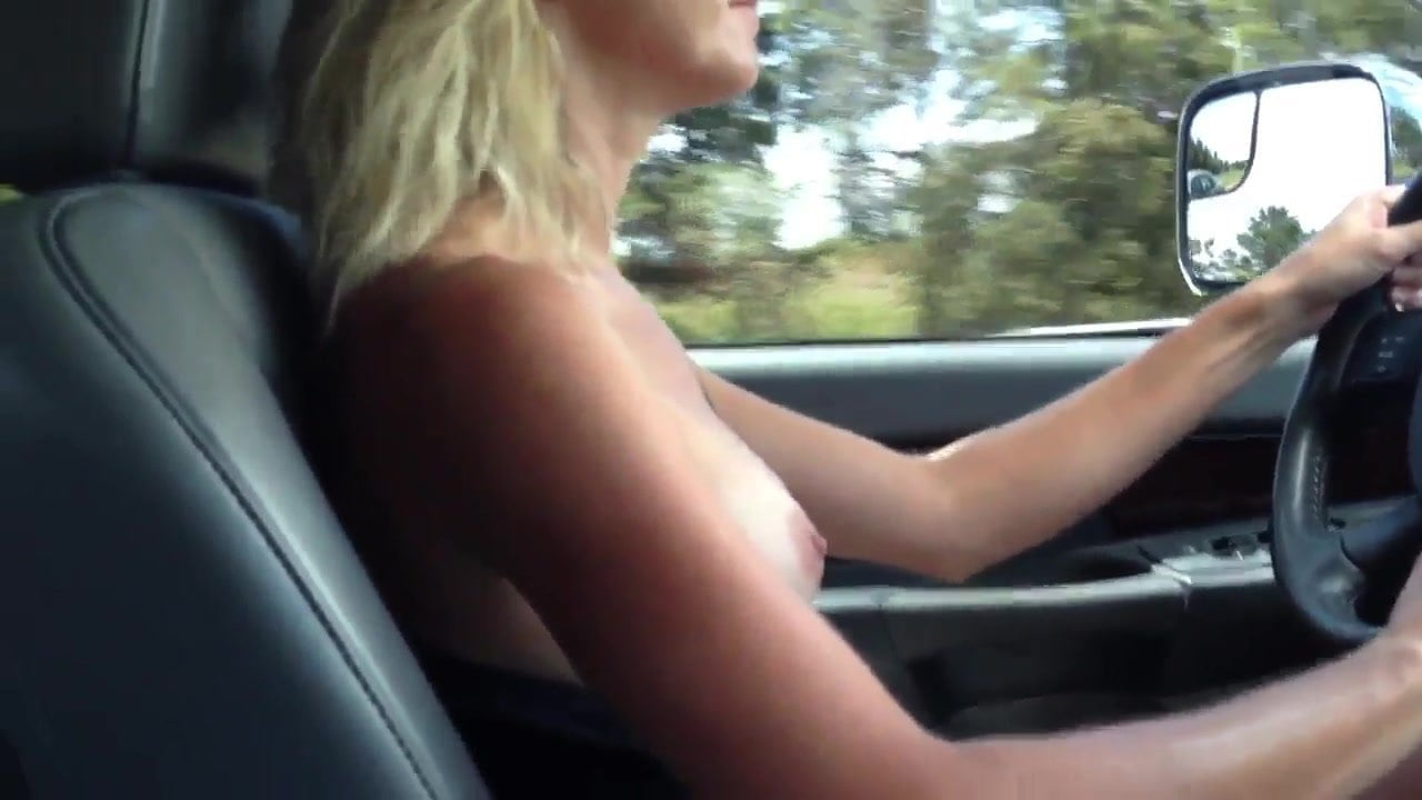 Busty milf driving topless on the highway