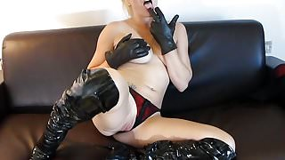 Kinky blonde masturbates with naughty soft leather gloves