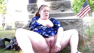 a fat mature masturbates in an American cemetery