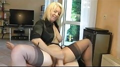 Hot Blonde Cougar heels and stockings gives a nice tug job!