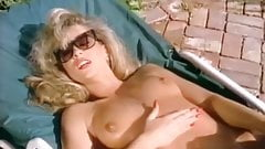 Please identify this sassy blonde in pink bikini masturbates