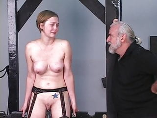Young blonde receives dog training from older master Len