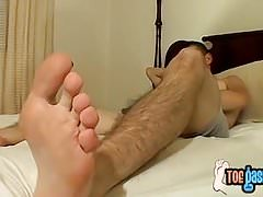 Cooper loves wanking his rock solid cock while showing feet