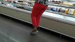 Mature latina at supermarket