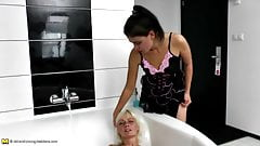 Mature mother licks not her daughter in bath