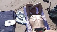 wife topless on beach