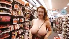 hot huge tits flashing in store who is she ?