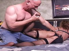 Mature whore in sexy lingerie gets a good pounding in bed