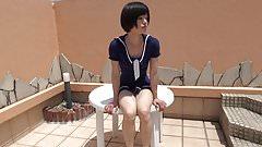 sitting crossdresser in one piece skirt