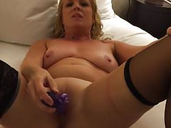 Milf toys pussy with rabbit and talks to camera
