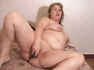 Chubby blonde plays with her shave pussy