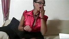 Mature in satin blouse and seamed stockings