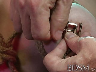 BDSM XXX Black haired sub has breasts tied to the ceiling