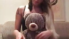 Blonde with teddy bear has big surprise.