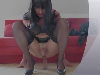 Dagmar rides dildo in mini chastity