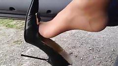 Milf outside high heels dangling