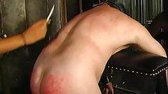 Hot looking mistress Delilah spanks her bent-over slaves ass