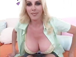 Big tittied MILF gets a huge load on her titties.