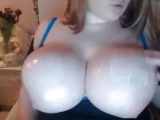 Huge tits getting lotion by BBW gal