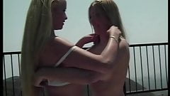 Beautiful tanned blonde teen lesbians make love on the deck