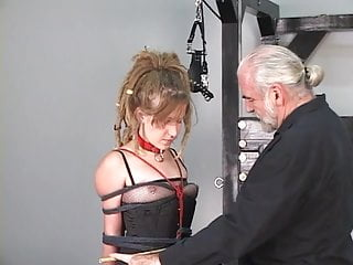 Dreadlock hippie bdsm girl loves to be restrained in basement by older master