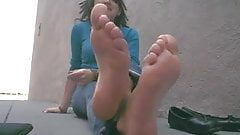 Woman shows her sexy feet