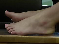 Sexy redhead coed's candid feet