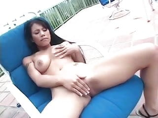 Luci Thai Lays Back And Rubs Her Pussy Outside