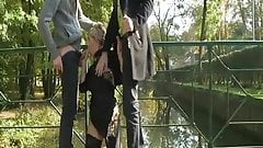 Lisa sucking two guys outdoor while husband filming's Thumb